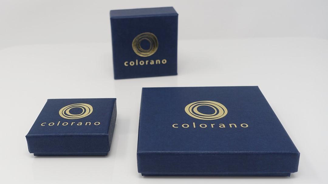 drei colorano schmuck etuis mit goldenem colorano logo aufgedruckt